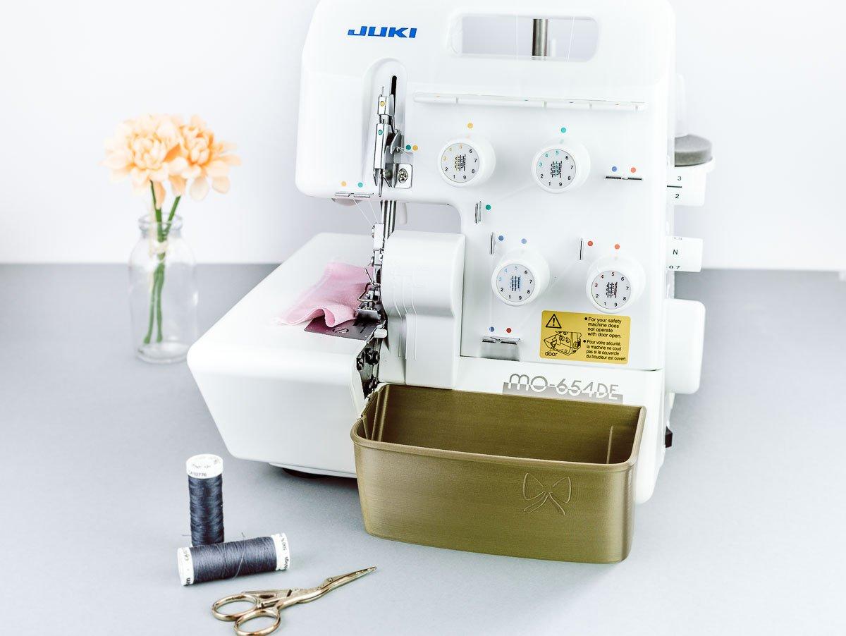 auffangbehälter juki MO-654DE overlock altgold